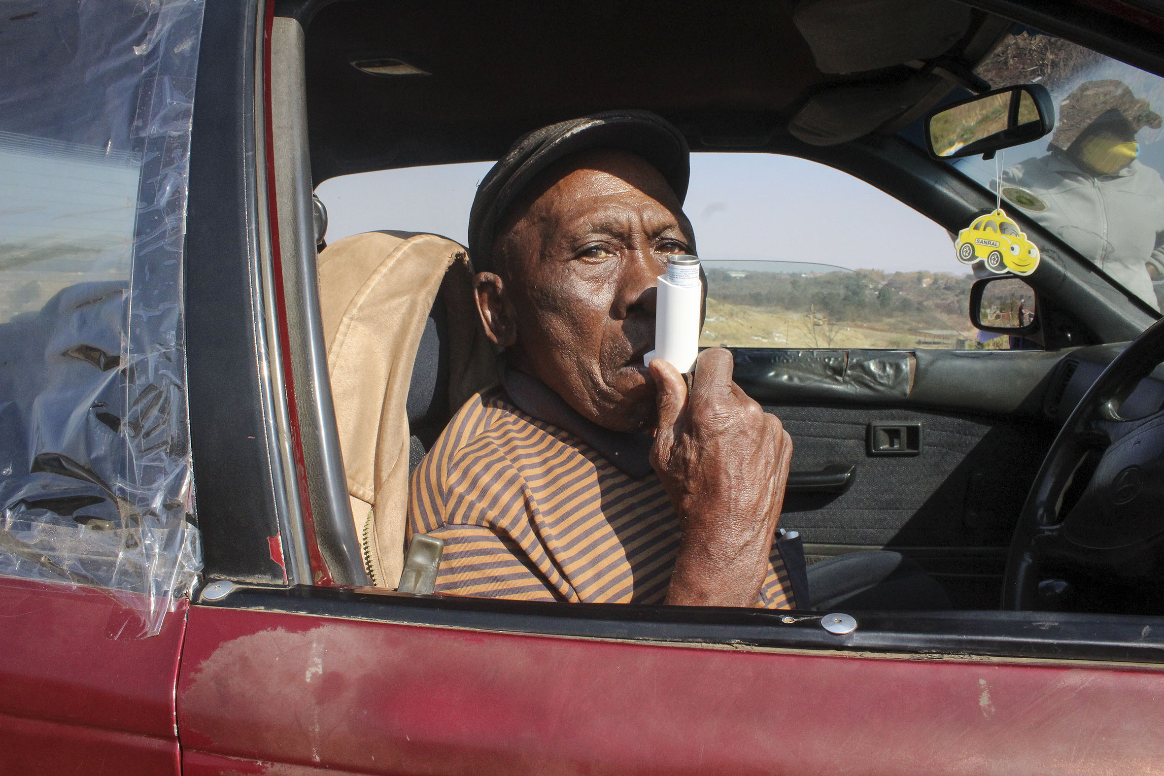 28 July 2020: Sobantu resident Mbuyiselwa Khumalo, 75, was diagnosed with asthma and high blood pressure more than a decade ago and uses an inhaler. When the pump doesn't help, he has to be nebulised at the local clinic. (Photograph by Tony Carnie)