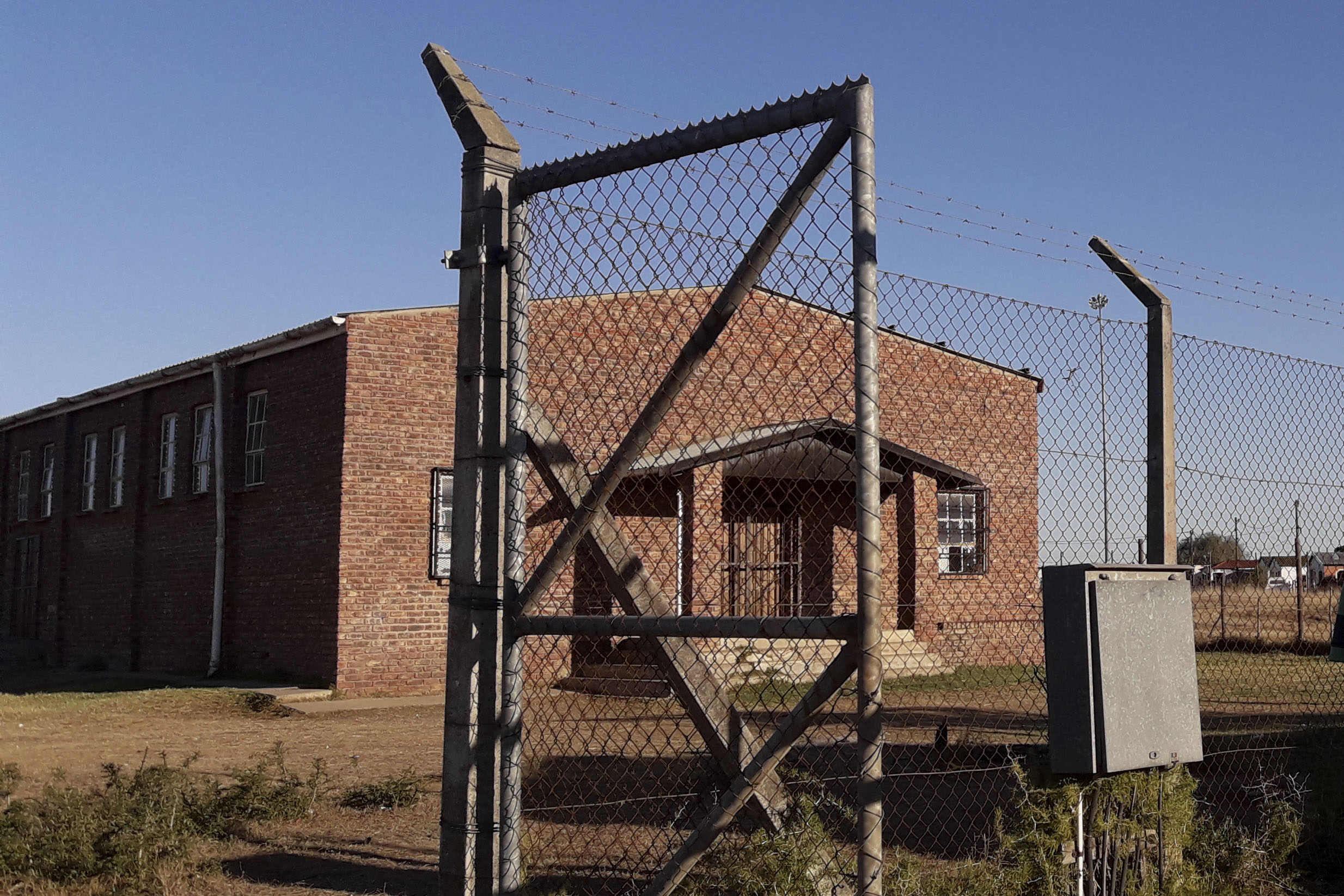 23 July 2020: The town's sole paralegal, Tuse Manene, works out of this abandoned and derelict building which has no electricity