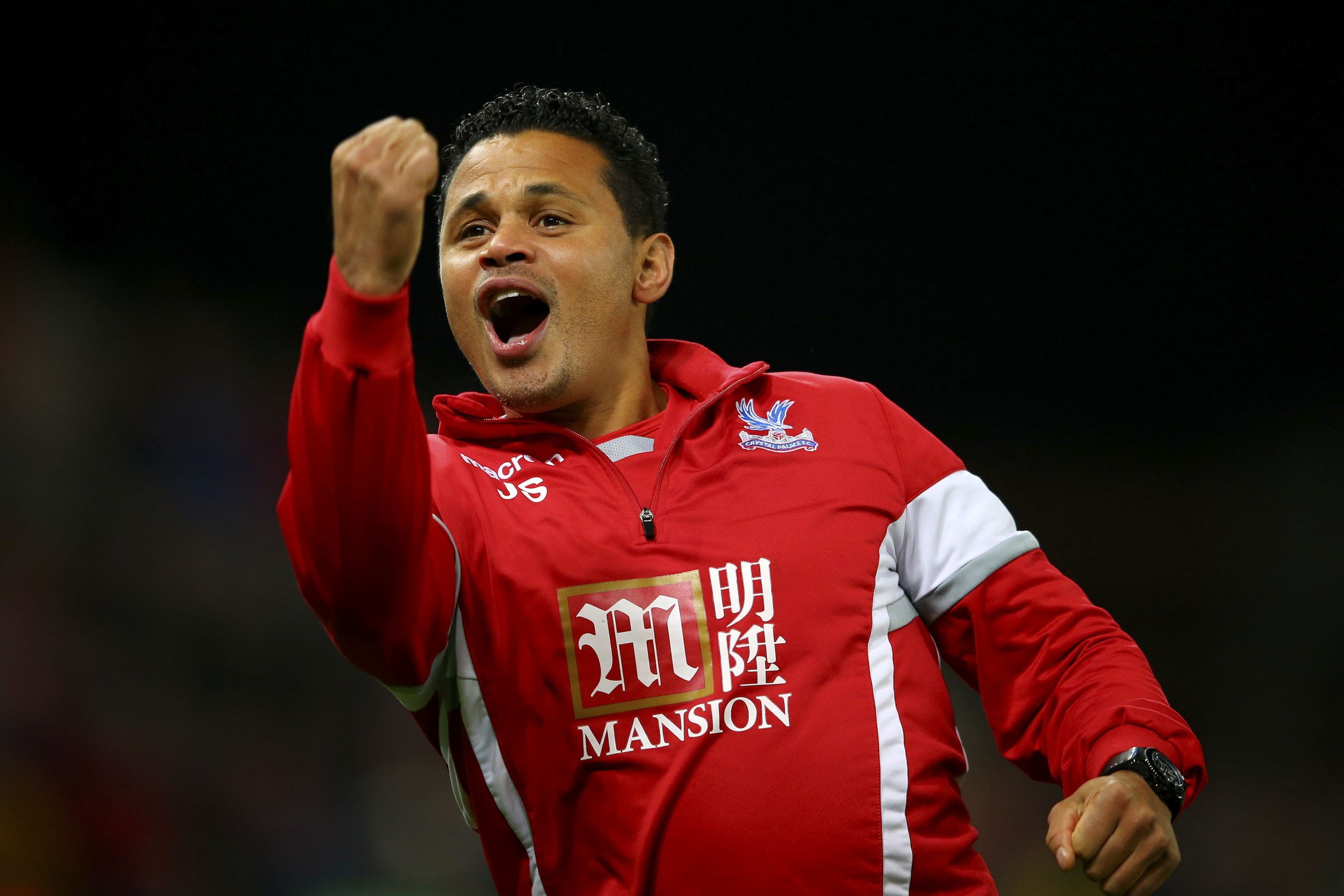 9 December 2015: Assistant coach John Salako celebrates at the final whistle of the Barclays Premier League match between Stoke City and Crystal Palace at the Britannia Stadium in Stoke-on-Trent, England. (Photograph by Richard Heathcote/ Getty Images)