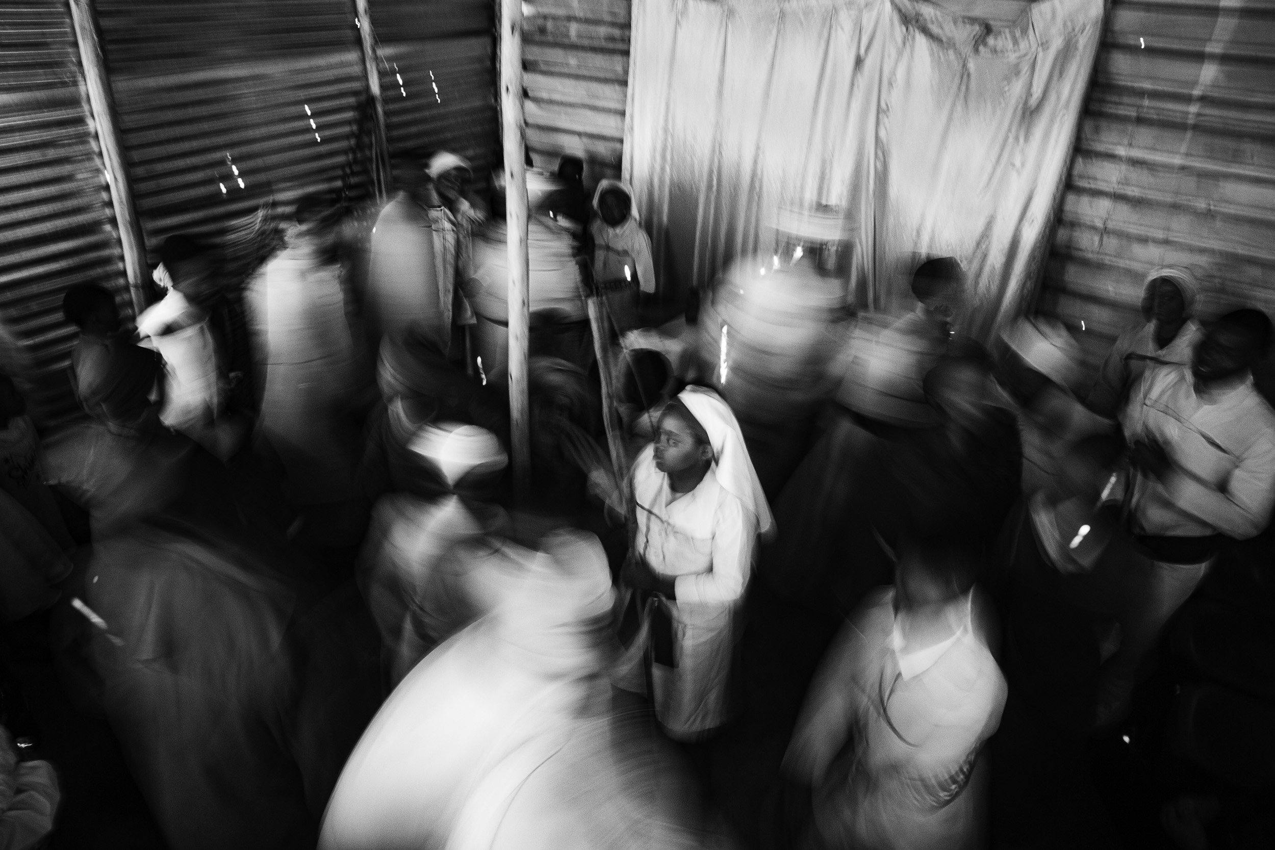 Undated: Hlomani Izikhali I – Congregants sing and pray while moving in a circular, anticlockwise direction at the start of a service at the church near the Nancefield Hostel in Soweto.