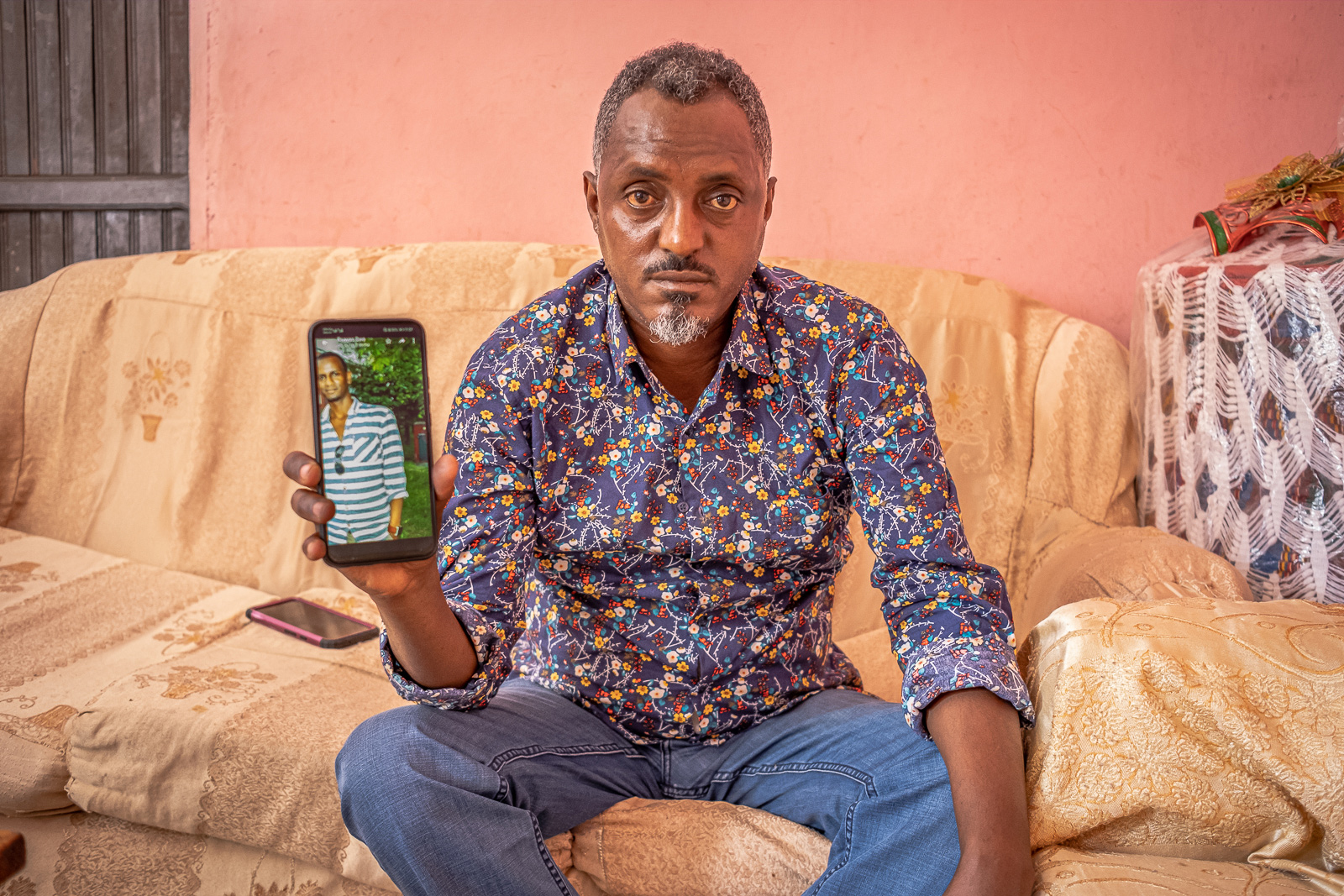 February 2020: Ephrem Fikru, Tekie's nephew, shows a photo of his uncle on his cellphone.