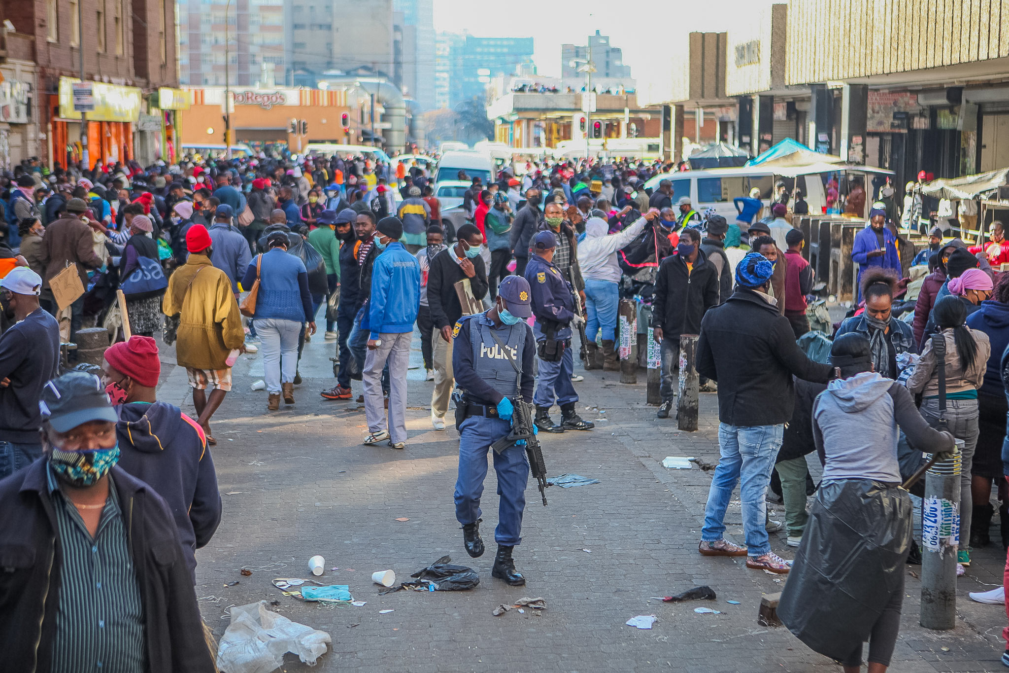 4 June 2020: Members of the South African Police Service monitor compliance with lockdown level three regulations in Johannesburg. (Photograph by Sharon Seretlo/ Gallo Images via Getty Images)
