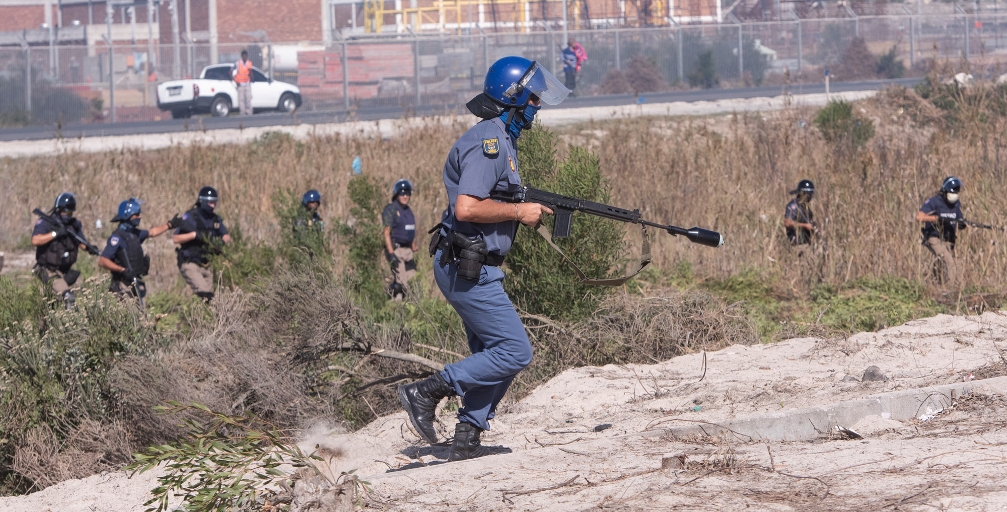 21 April 2020: Public order police and members of the Cape Town Metro Police clash with civilians in the Empolweni shack settlement who had started building structures on private land during the lockdown. (Photograph by Brenton Geach/ Gallo Images via Getty Images)