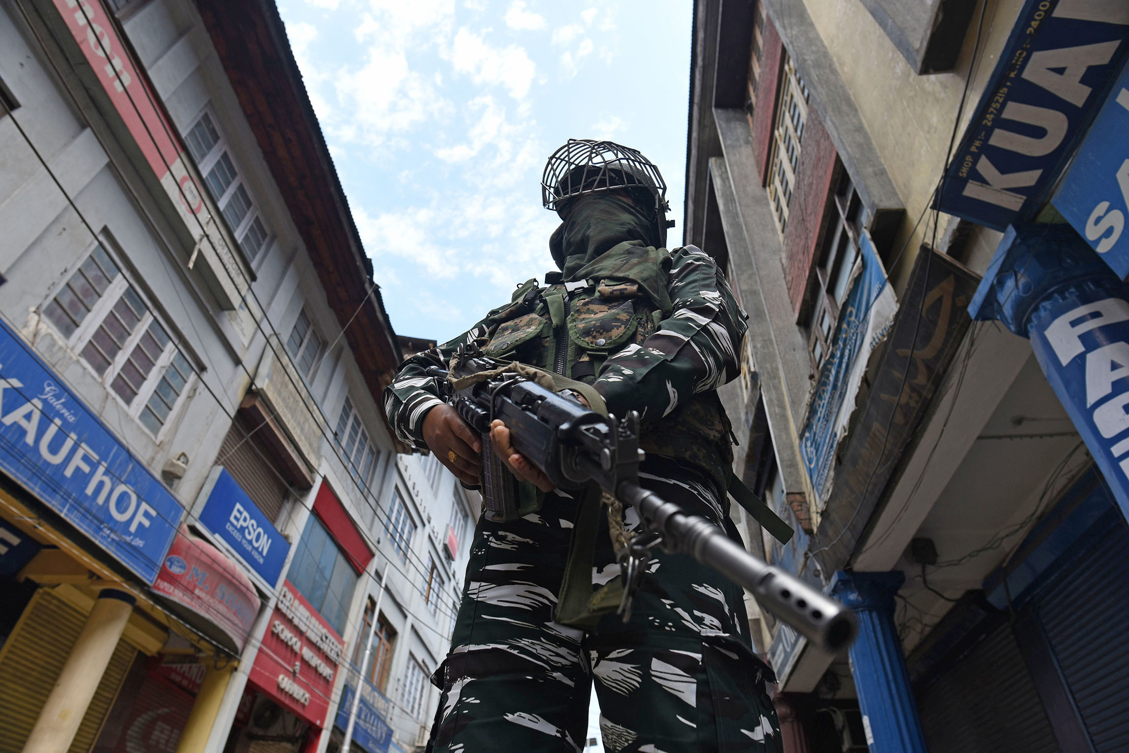 5 August 2020: A paramilitary soldier stands guard in Srinagar on the first anniversary of the abrogation of Article 370, which had guaranteed Jammu and Kashmir a measure of autonomy. (Photograph by Waseem Andrabi/ Hindustan Times via Getty Images)
