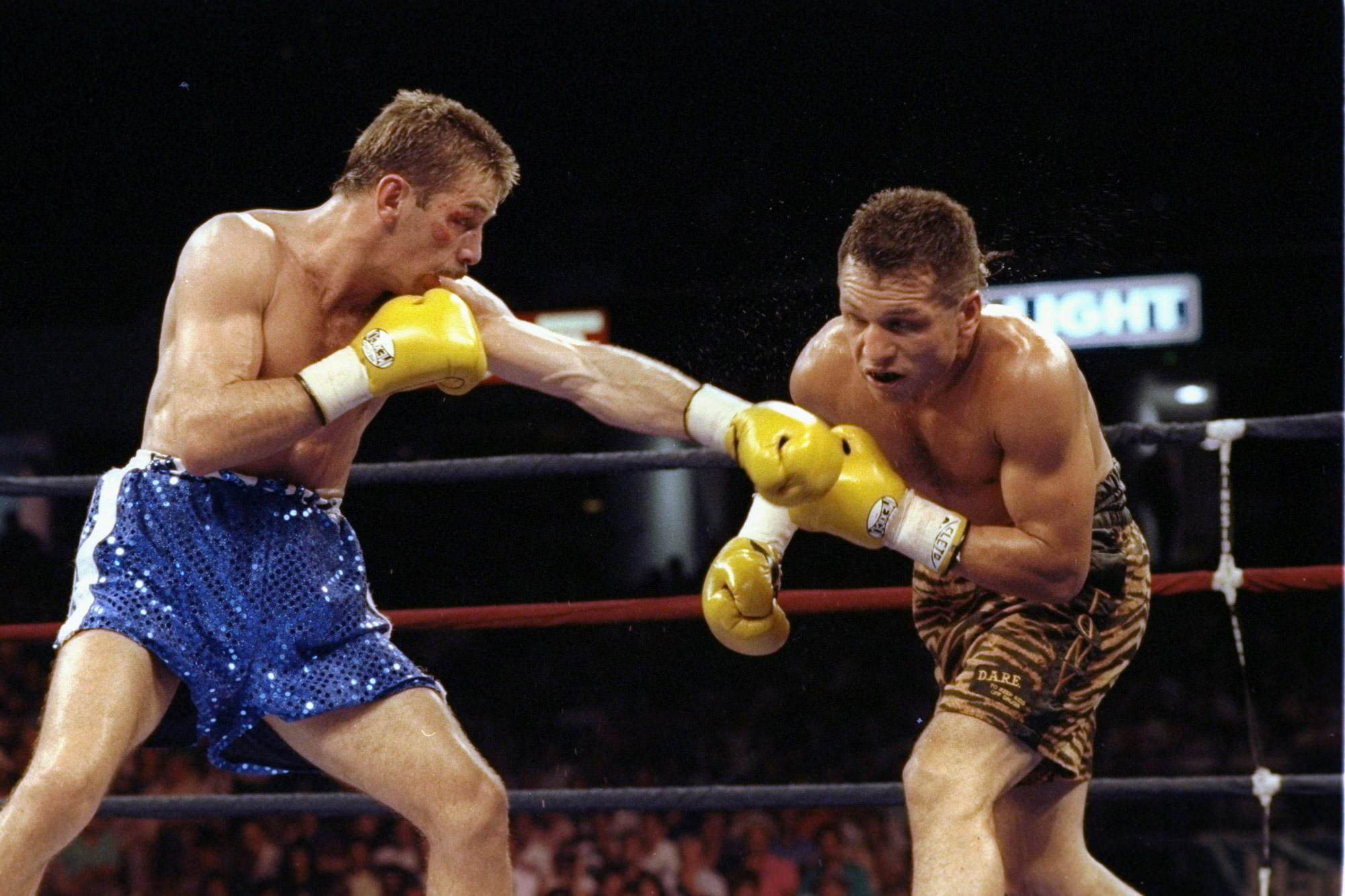 1 January 1993: From left, South African Brian Mitchell and American Tony Lopez in action. (Photograph by Otto Greule/ Allsport/ Getty Images)