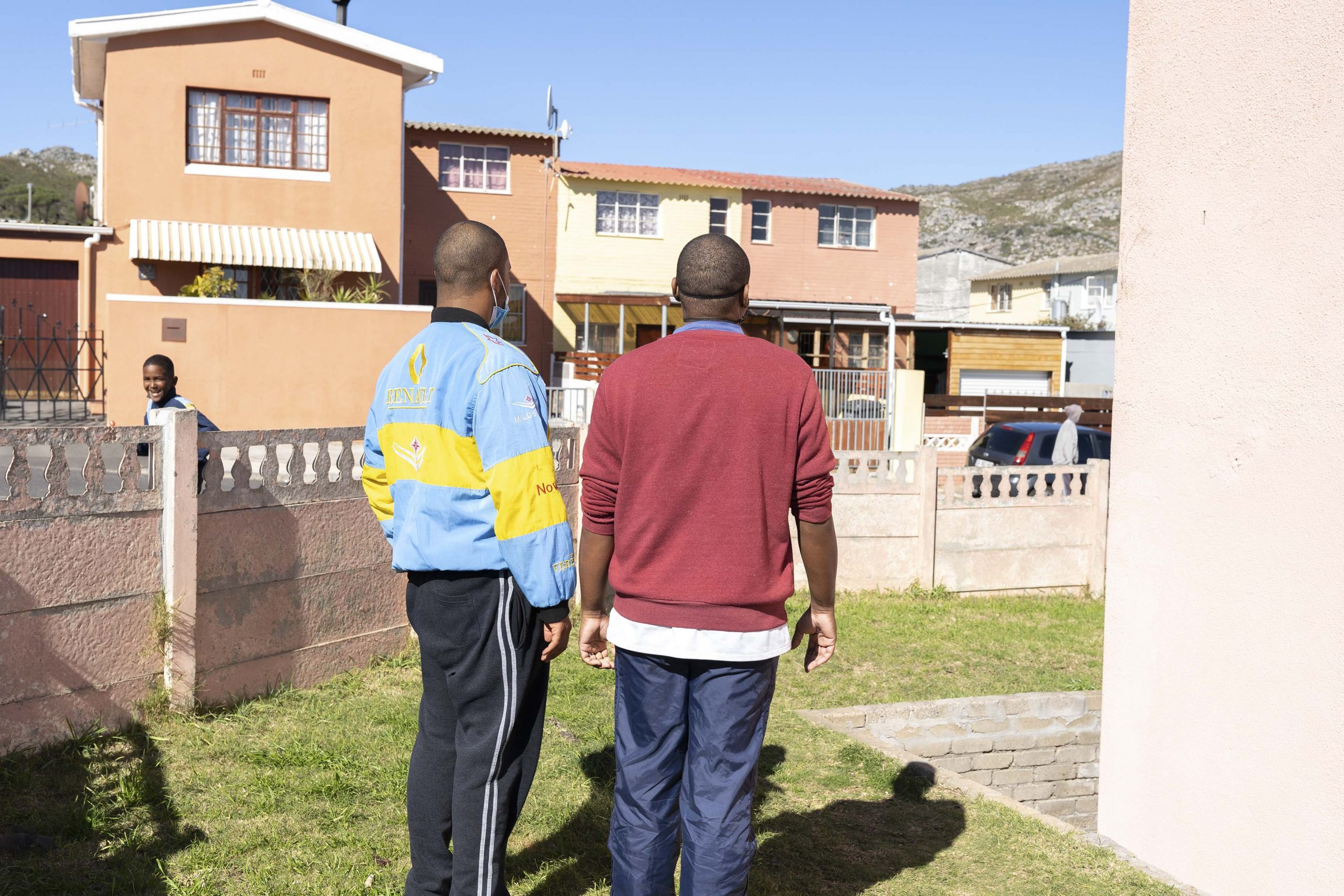 27 July 2020: From left, Eben Collins and Craig Butler investigate a commotion in the street outside the care centre. Butler is Ramona Lamb's cousin and wanted to get involved to help the community. Some of Lamb's neighbours were giving her a hard time about setting up the centre and Butler felt he could help explain to them why she had undertaken the project. Butler is a soccer coach who loves working with people and he used his people skills to win over most of Lamb's neighbours.