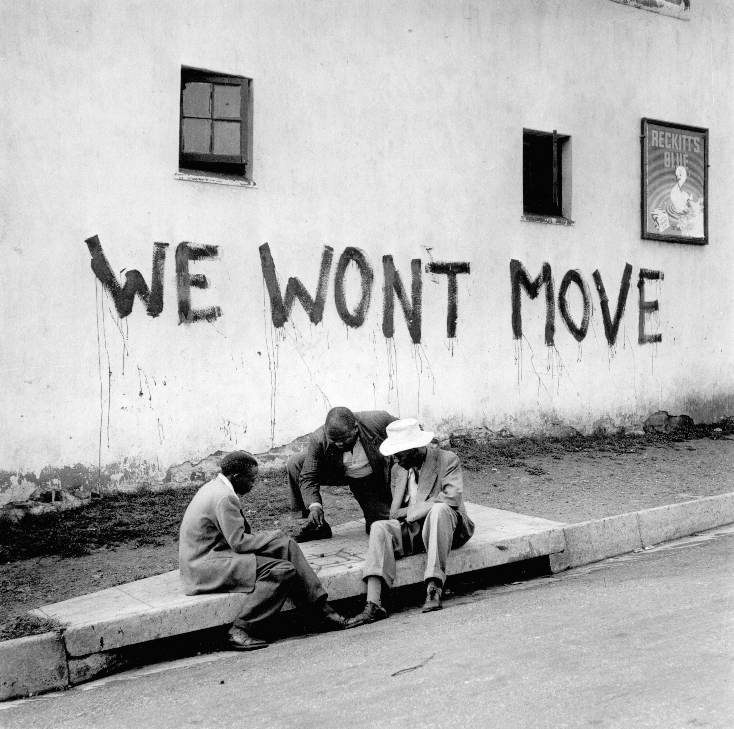 "Circa 1955: In Sophiatown, the people said, ""We won't move!"" When the police arrived that first day, people banged stones and iron bars against the lamp posts. (Photograph courtesy of the Jürgen Schadeberg estate)"