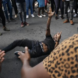 12 March 2021: Students from the Wits Economic Freedom Fighters sing struggle songs and dance near the spot where Mthokozisi Ntumba was shot and killed by police during protests against financial exclusion. (Photograph by James Puttick)