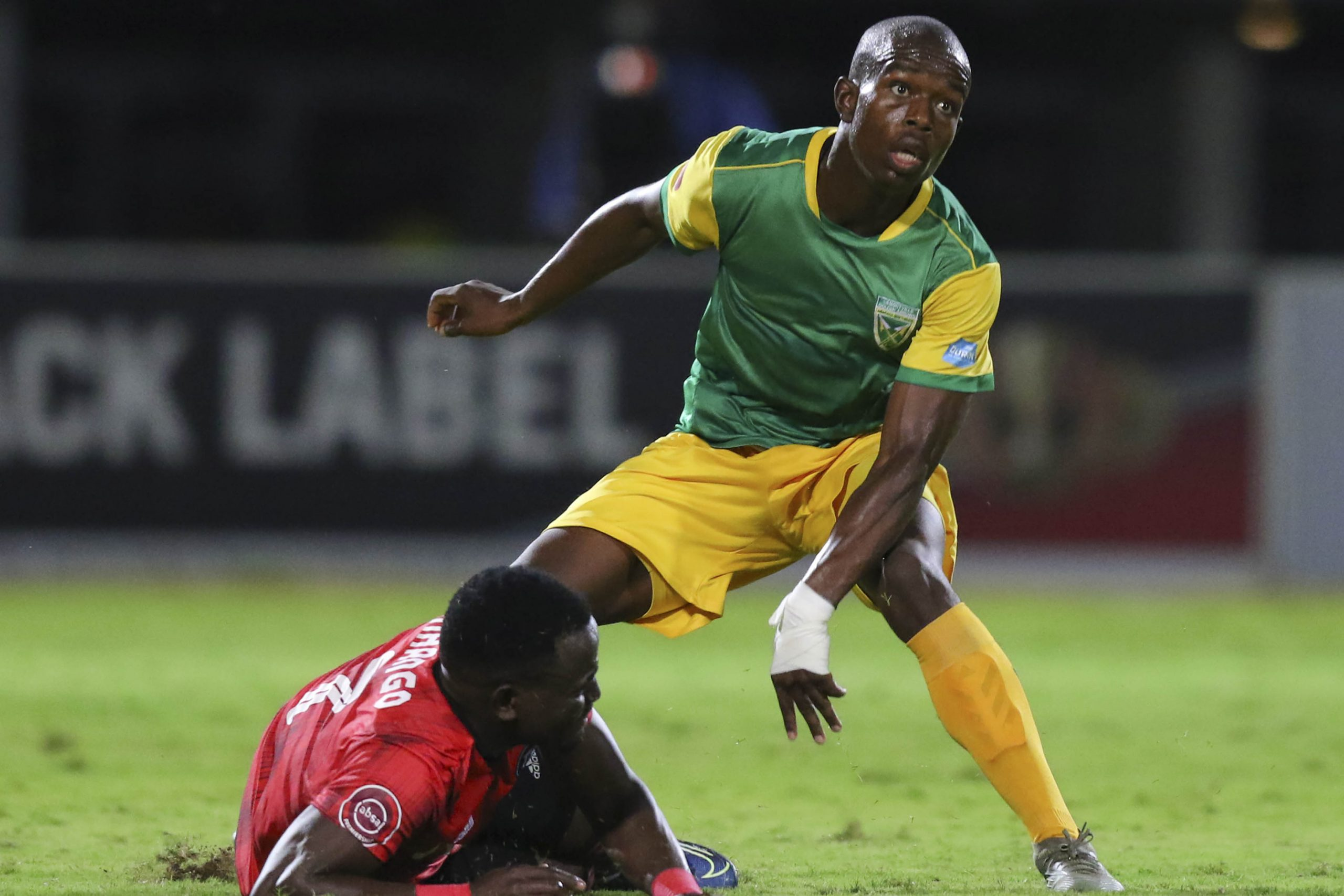 7 March 2020: Nkosinathi Sibisi of Golden Arrows and Gabadinho Mhango of Orlando Pirates during an Absa Premiership match at Sugar Ray Xulu Stadium in Durban, South Africa. (Photograph by Anesh Debiky/ Gallo Images)