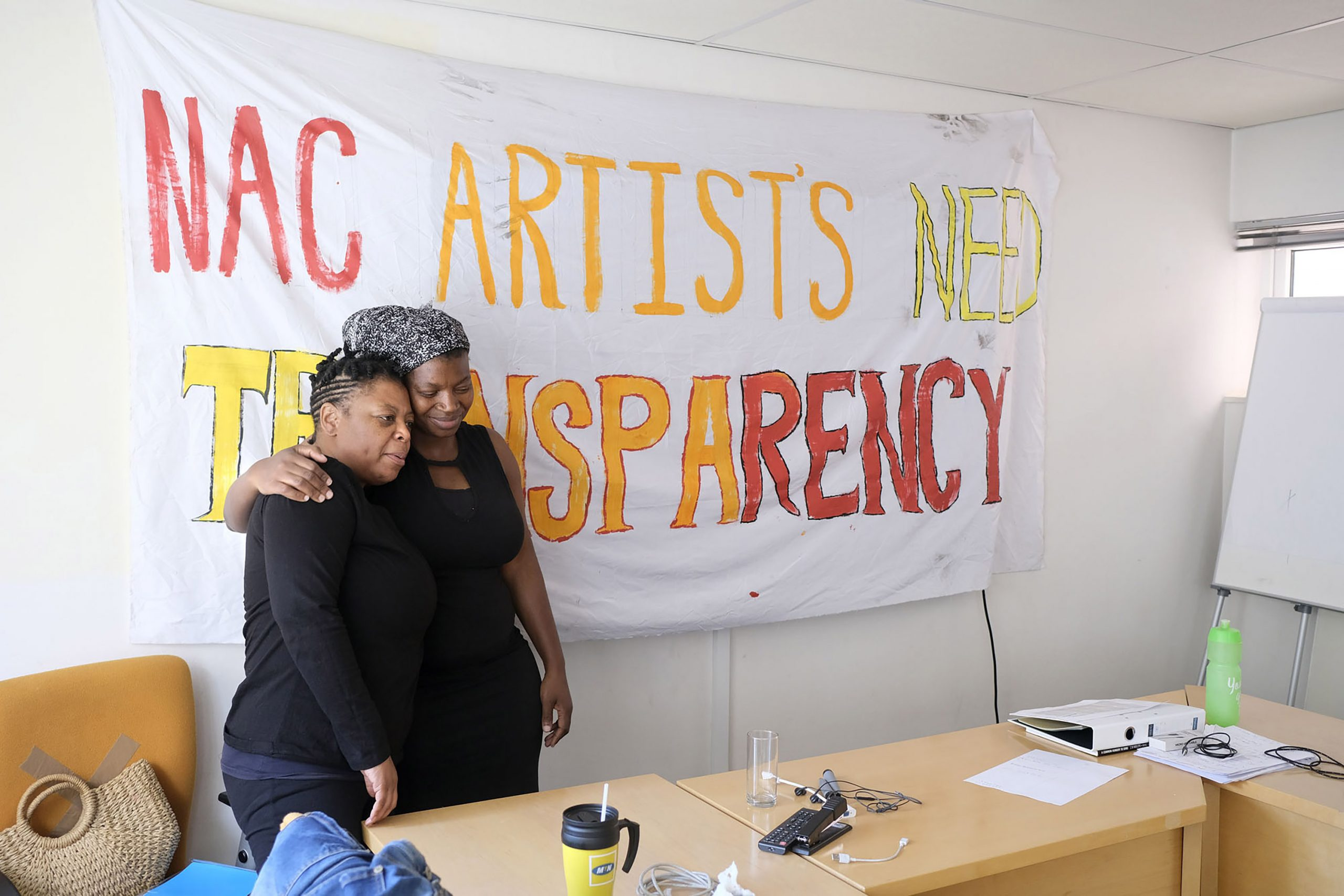 15 March 2021: From left, Sibongile Mngoma gets support from Thoko Hlala in the National Art Council's boardroom, where artists are staging a sit-in to protest the mismanagement of funds. (Photograph by John Hogg)