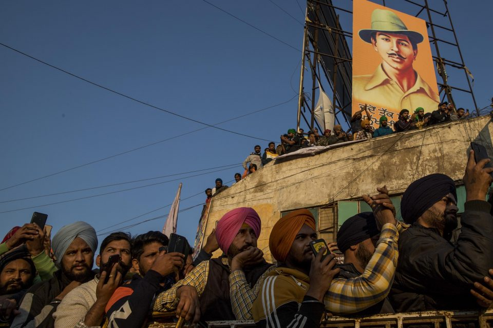 18 December 2020: Indian farmers participate in a protest at Delhi's Singhu border. They say laws that deregulate the sale of crops put them at risk of losing their livelihoods and land. (Photograph by Anindito Mukherjee/ Getty Images)